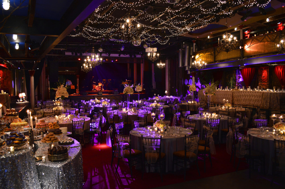 Lighting and linen colors create the perfect ambiance for this wedding.